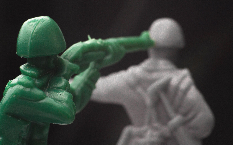 Plastic Army Man Shooting Enemy